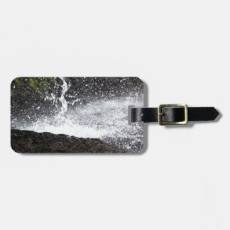 Detail of a small waterfall luggage tag