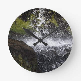 Detail of a small waterfall round clock