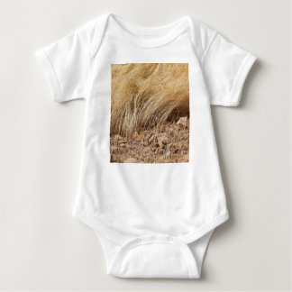 Detail of a teff field during harvest baby bodysuit