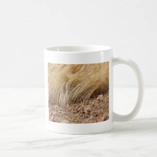 Detail of a teff field during harvest coffee mug