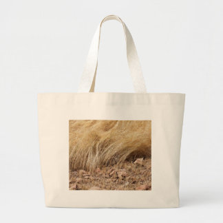 Detail of a teff field during harvest large tote bag