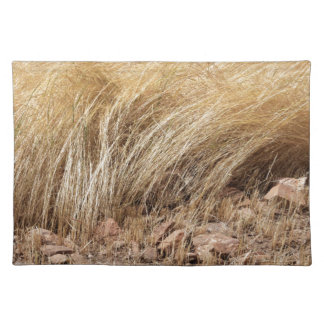 Detail of a teff field during harvest placemat