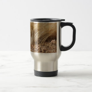 Detail of a teff field during harvest travel mug