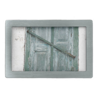 Detail of a wall of an old house with a window belt buckle