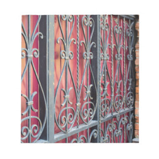 Detail of an old building with an iron fence notepad