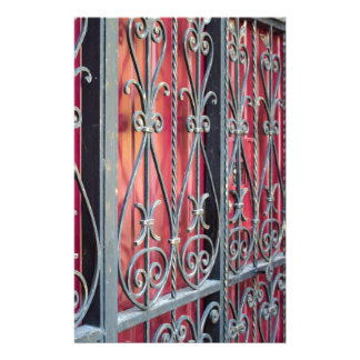 Detail of an old building with an iron fence stationery