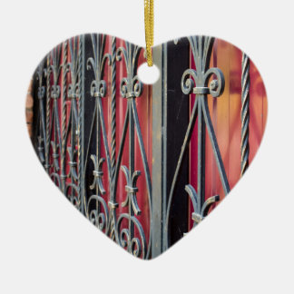 Detail of an old iron fence ceramic heart ornament