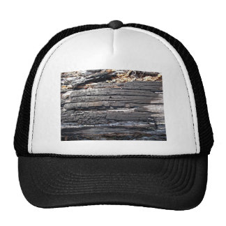 Detail of burnt wooden log with damaged surface trucker hat