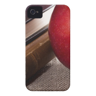 Detail of old books in hardcover and red apple Case-Mate iPhone 4 cases