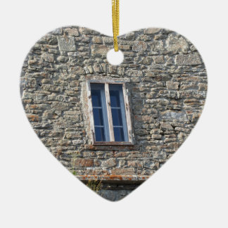Detail of the medieval sanctuary facade ceramic heart ornament