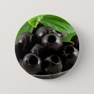 Detailed close-up view of the black olives 2 inch round button