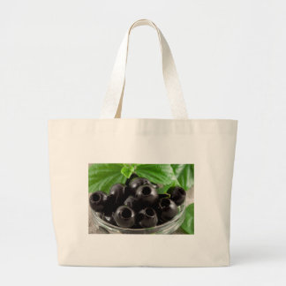 Detailed close-up view of the black olives large tote bag