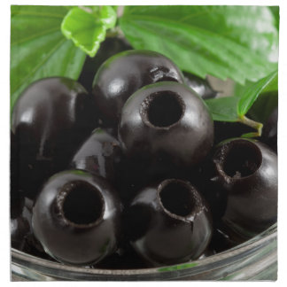 Detailed close-up view of the black olives napkin