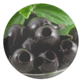 Detailed close-up view of the black olives plate