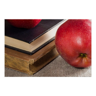Detailed close-up view of the red apples and book poster