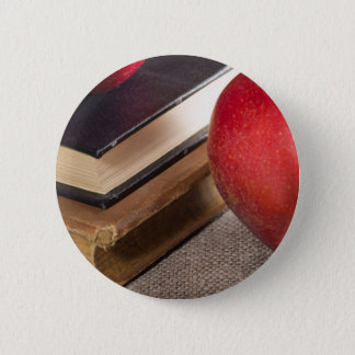 Detailed close-up view of the red apples and old 2 inch round button