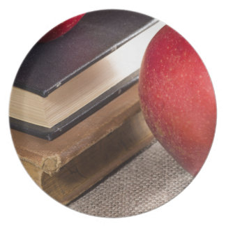 Detailed close-up view of the red apples and old dinner plate