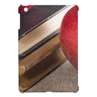 Detailed close-up view of the red apples and old iPad mini cover