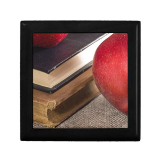 Detailed close-up view of the red apples and old jewelry boxes