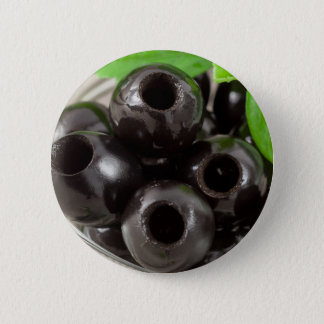 Detailed macro view of the black olives 2 inch round button