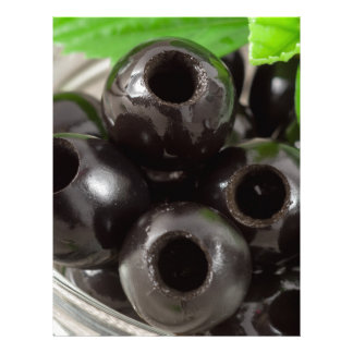 Detailed macro view of the black olives letterhead