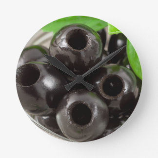 Detailed macro view of the black olives round clock