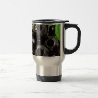Detailed macro view of the black olives travel mug