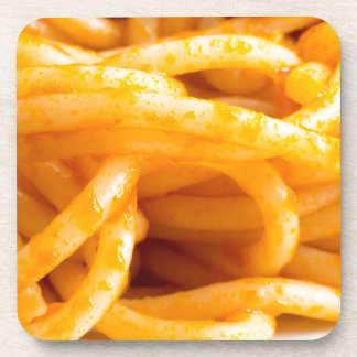 Detailed macro view on cooked spaghetti on a plate coaster