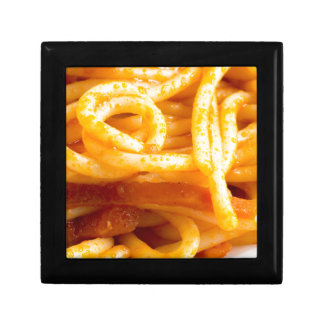 Detailed macro view on cooked spaghetti on a plate gift box