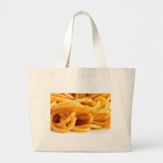 Detailed macro view on cooked spaghetti on a plate large tote bag