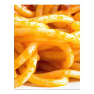 Detailed macro view on cooked spaghetti on a plate letterhead