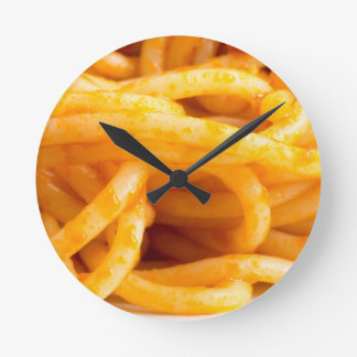 Detailed macro view on cooked spaghetti on a plate round clock