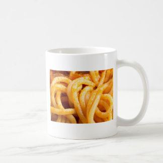 Detailed macro view on cooked spaghetti with sauce coffee mug