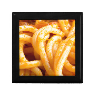 Detailed macro view on cooked spaghetti with sauce gift box