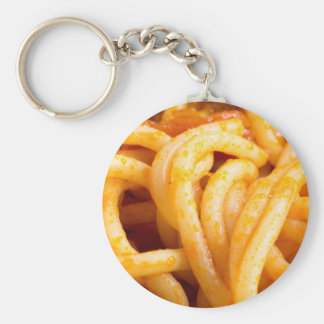 Detailed macro view on cooked spaghetti with sauce keychain