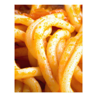 Detailed macro view on cooked spaghetti with sauce letterhead