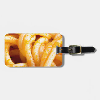 Detailed macro view on cooked spaghetti with sauce luggage tag