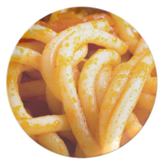 Detailed macro view on cooked spaghetti with sauce plate
