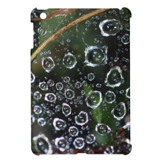 Dew drops in a spider net iPad mini cases