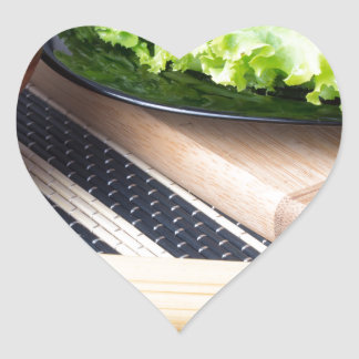 Diagonal composition on a table with a fresh salad heart sticker
