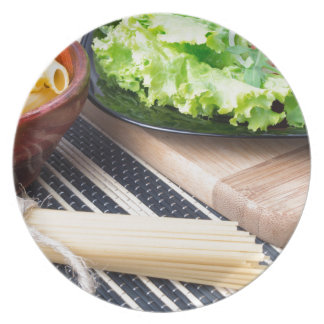 Diagonal composition on a table with a fresh salad plate