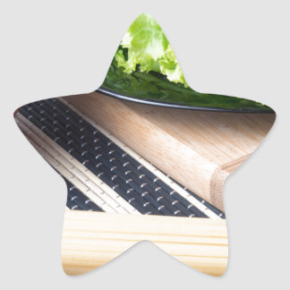 Diagonal composition on a table with a fresh salad star sticker