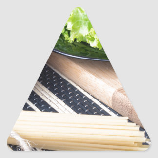 Diagonal composition on a table with a fresh salad triangle sticker