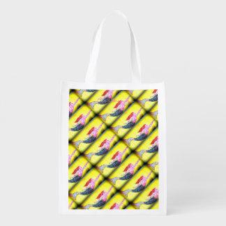 diagonal pink mosiac mermaids swimming on yellow reusable grocery bags