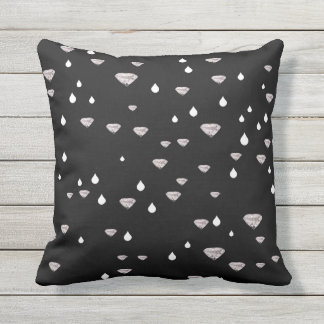 diamonds raindrops scattered on black outdoor pillow