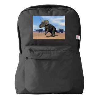 Diceratops/nedoceratops dinosaurs in the desert backpack