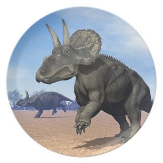 Diceratops/nedoceratops dinosaurs in the desert plate