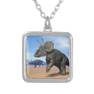 Diceratops/nedoceratops dinosaurs in the desert silver plated necklace