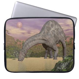 Dicraeosaurus dinosaur drinking - 3D render Laptop Sleeve