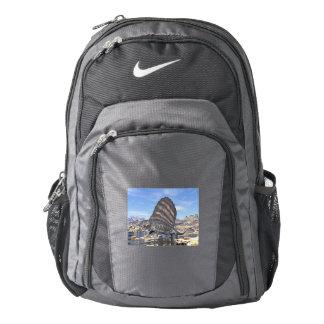 Dimetrodon standing in a pond in the desert backpack